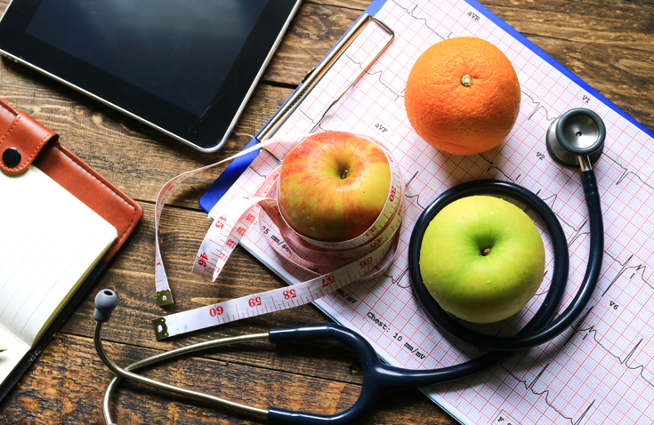 fruit, stethoscope, vital sign readout, notebook